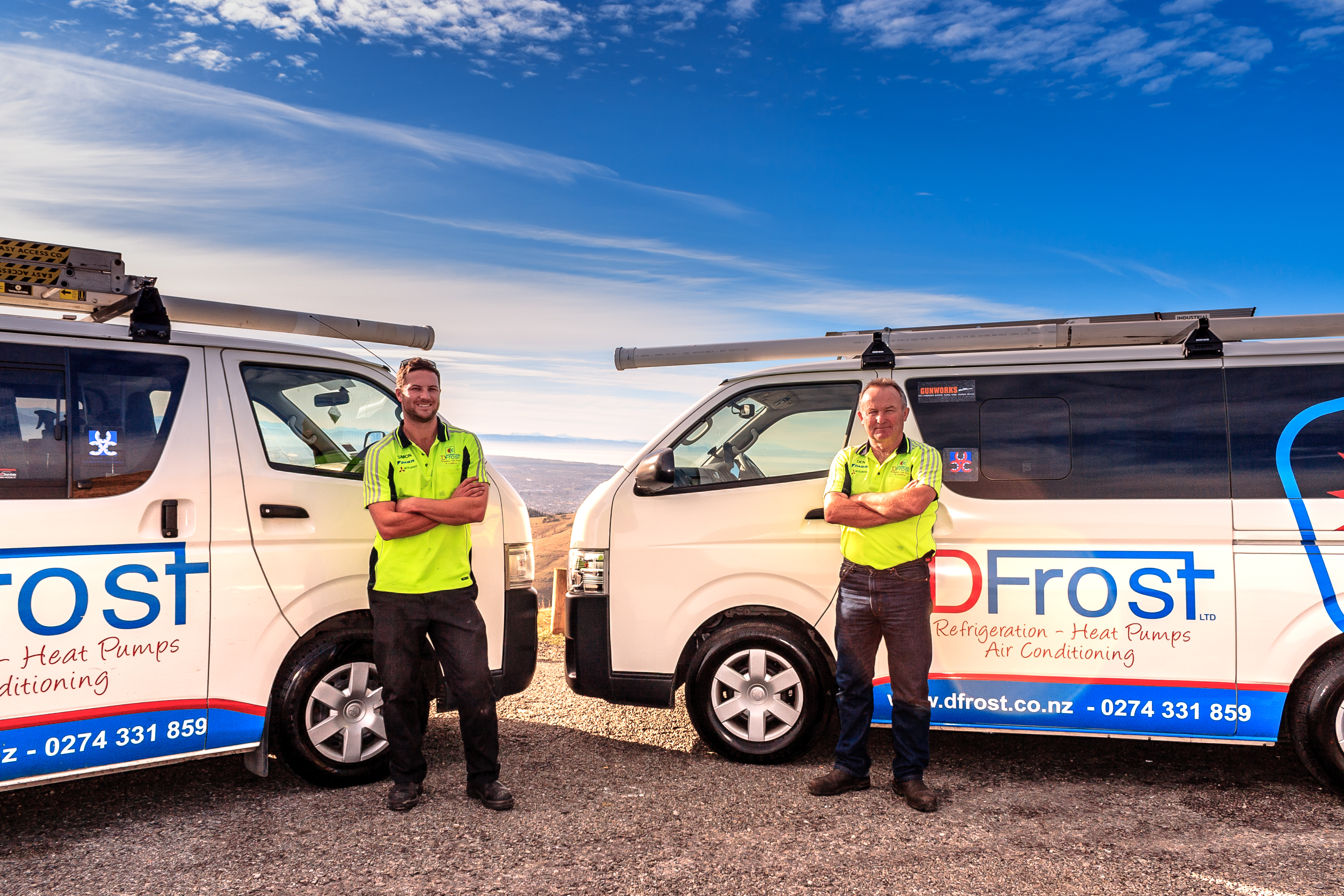 simon and dennis in front of dfrost work vans